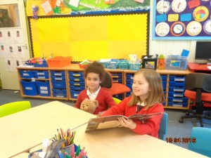 Aaliyah reads to 2 of the Reception boys!